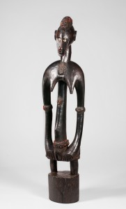 Female figure. Unidentified artist. Wood, cowrie shells, abrus seeds, latex; h. 90.5 cm. Private Collection. BAMW Photography