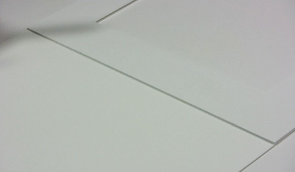 Attaching a mat to a backing board | Metropolitan Picture Framing