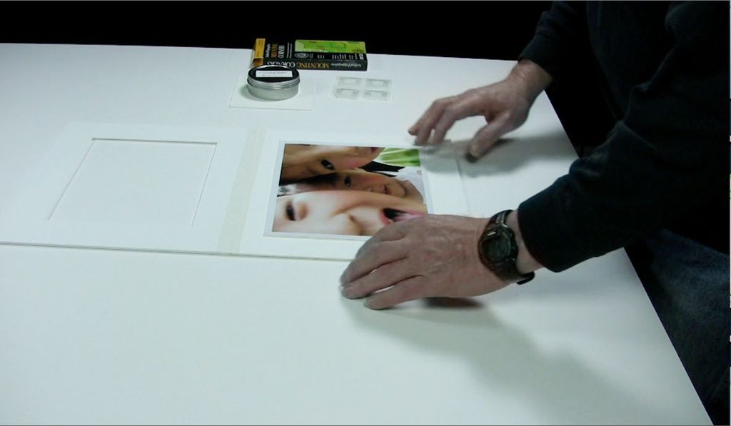 Attaching photographs with plastic mounting corners | Metropolitan ...